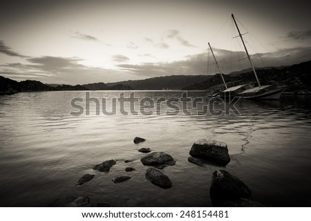 sunken boat in the abandoned place - stock photo