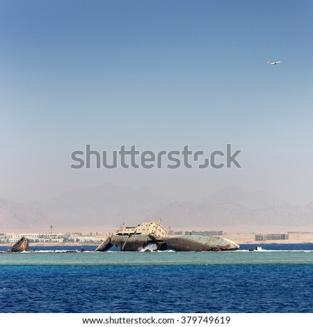 sunken ship on a background of mountains