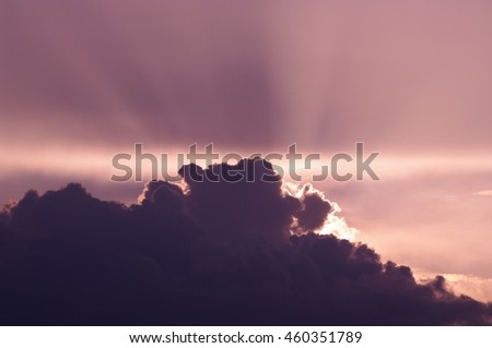 Sunlight and Clouds in the Purple/Pink Sky - stock photo