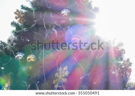 sunlight and flare on christmas tree decorating with tinsel ornament decorating  for holiday concept background - stock photo
