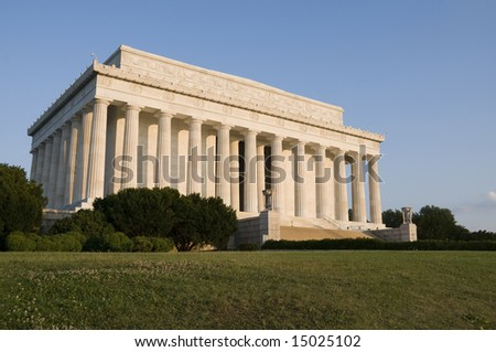 Sunlight bathes the eastern facade of the Lincoln Memorial in Washington, DC, shortly after dawn.