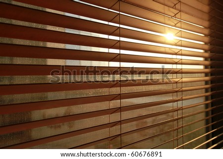 Sunlight behind vertical blinds - stock photo