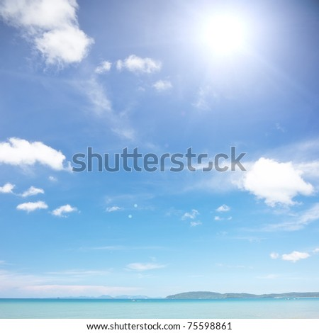 Sunlight, blue sky and tranquil sea - idyllic place - stock photo