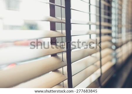 Sunlight coming through venetian blinds by the window - stock photo