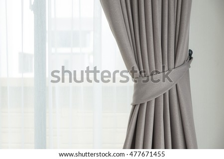 Sunlight coming through window with curtain