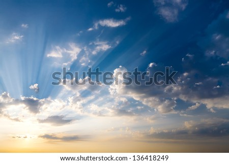 Sunlight in the dramatic sunset sky - stock photo