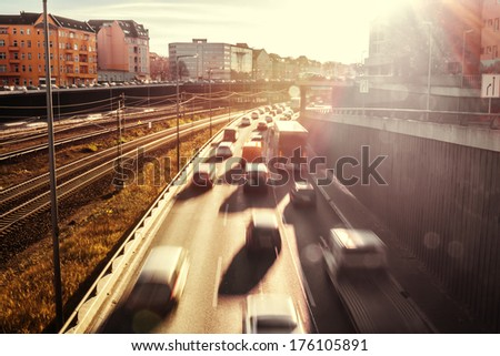 sunlight on a highway in berlin - stock photo