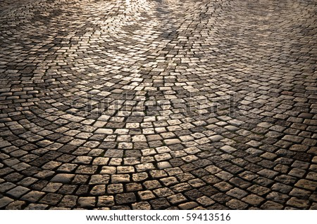 Sunlight on cobblestone - stock photo