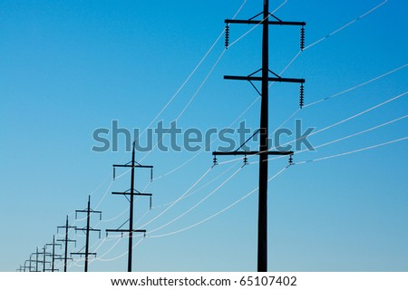Sunlight on electrical power lines - stock photo