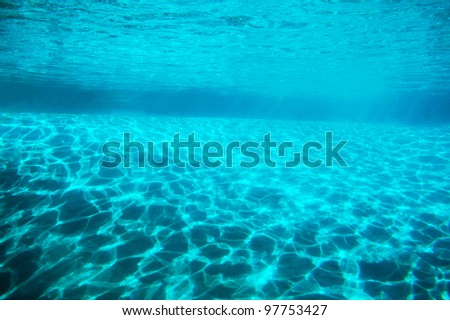 Sunlight reflecting on the bottom with the shape of the waves. - stock photo