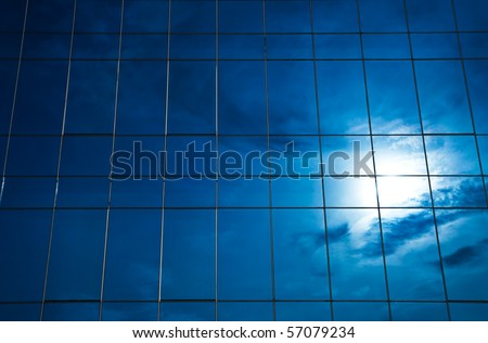 Sunlight reflection on glass building - stock photo