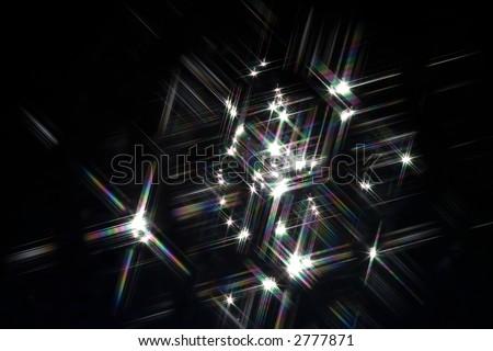Sunlight reflections on water shot through a cross screen filter - stock photo