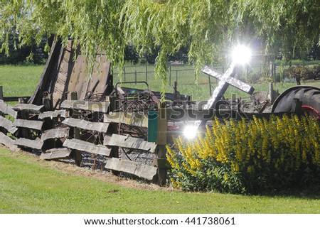 Sunlight reflects off a Christian Cross displayed in a rural area/Rural Christian Faith/A Christian Cross displayed in a rural area.