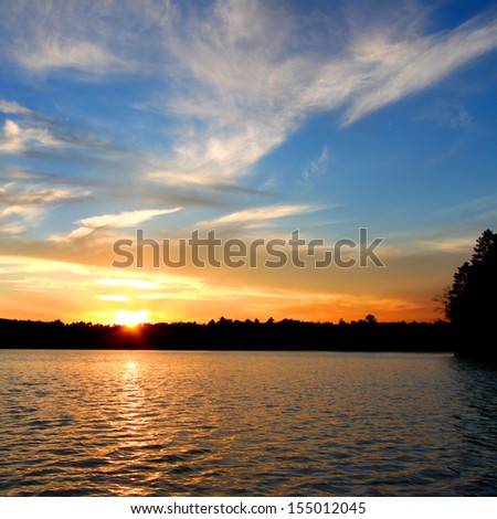 Sunlight reflects off ripples of Sweeney Lake in Wisconsin - stock photo