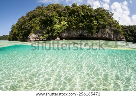 Sunlight ripples across a shallow sand flat in Palau, Micronesia. Palau is known for its beautiful rock islands and world class scuba diving and snorkeling. - stock photo