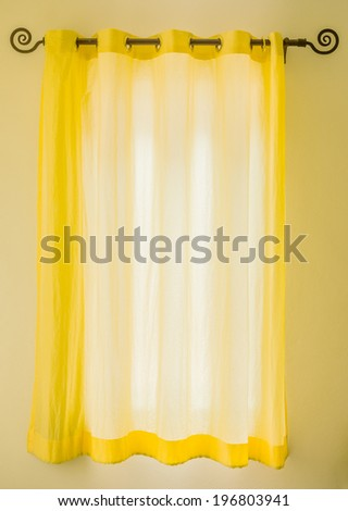 Sunlight shine out of yellow fabric curtain in sunshine day - stock photo