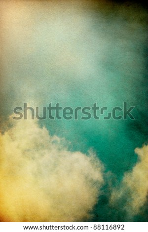 Sunlight shining through textured vintage clouds.  Image has a pleasing paper grain and texture at 100%. - stock photo