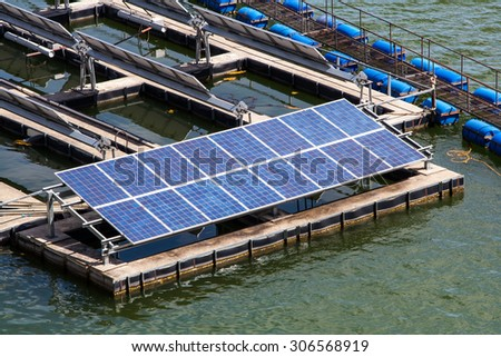 Sunlight Solar Energy on Dam - stock photo