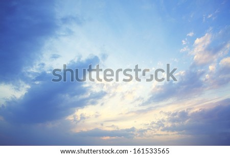 Sunlight streaming through a cloudy sky. - stock photo