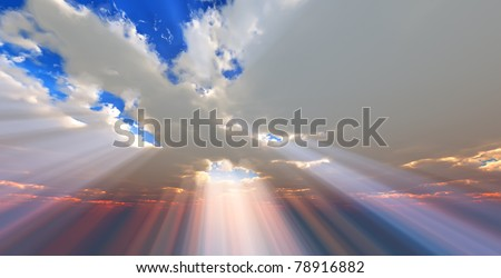Sunlight through the clouds - stock photo