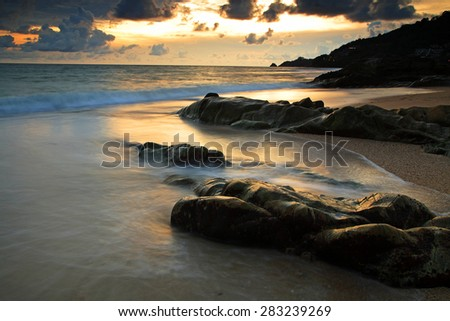 sunlight touching motion wave and the rock at Kalim Beach, Phuket, Thailand, Seascape - stock photo