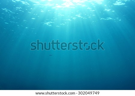 Sunlight underwater background - stock photo