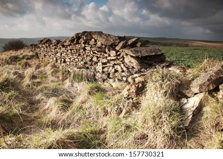 Sunlit dry stone wall North York Moors, England - stock photo