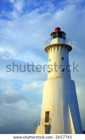sunlit lighthouse - stock photo