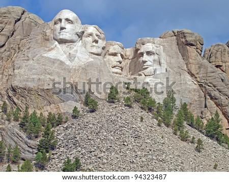Sunlit Presidential faces at Mt. Rushmore National Memorial, Keystone, South Dakota - stock photo