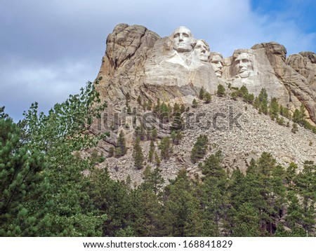Sunlit Presidential faces of George Washington, Thomas Jefferson, Theodore Roosevelt, and Abraham Lincoln at the Mt. Rushmore National Monument, Keystone, South Dakota - stock photo