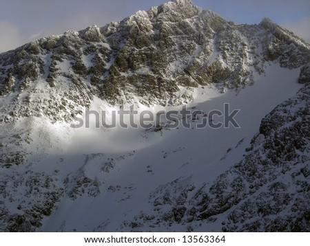 Sunlit summit atop a ski glacier at Blackcomb Mountain, British Columbia - stock photo