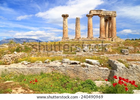 Sunlit temple of Apollo surrounded by red spring flowers, Corinth, Greece - stock photo