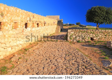 Sunlit walls of the Palamidi Castle, a Venetian fortress built near Nafplio, Greece - stock photo