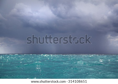 Sunny Adriatic Sea waters waiting for stormy weather; Dark dangerous clouds and Sea landscape - stock photo