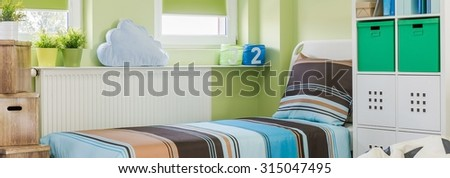 Sunny and cozy room for a boy in the house  - stock photo