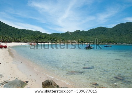 Sunny and warm tropical beach. Bay of Cham Islands near Hoi An( Hoian) and Da Nang( Danang), Central Vietnam. - stock photo