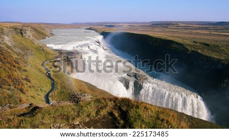 Sunny autumn day at Gullfoss Waterfall in Iceland - stock photo