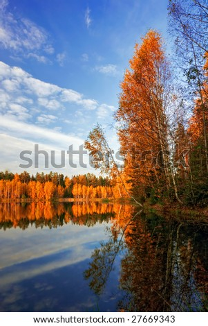 Sunny autumn lake. It is photographed in Russia. 60 kilometers from Moscow.