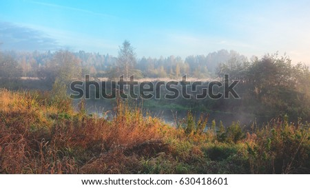 Sunny autumn landscape with river