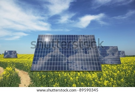 sunny batteries on blue sky and meadow background
