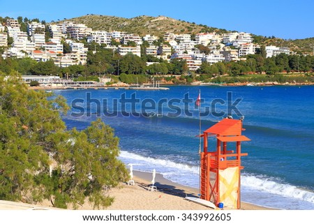 Sunny beach and isolated lifeguard tower, Greece - stock photo