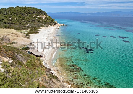 Sunny beach and summer resort at Kassandra of Halkidiki peninsula in Greece - stock photo