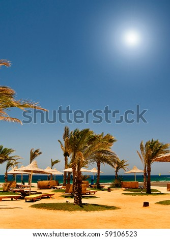 Sunny beach in the tropical country. - stock photo