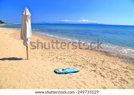 Sunny beach on the shore of the Aegean sea, Greece - stock photo