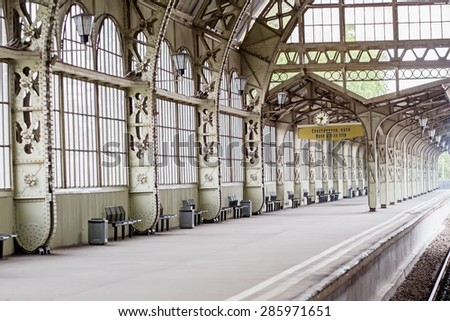 "Sunny beam at empty platform at Vitebsk railway station in St.-Petersburg, Russia. There is an inscription ""Have a nice trip"" on english and russian languages"
