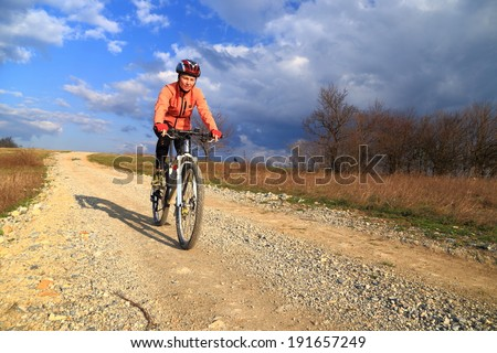 Sunny bike ride on dirt cover countryside road