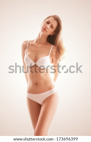 sunny blond woman in white underwear - stock photo