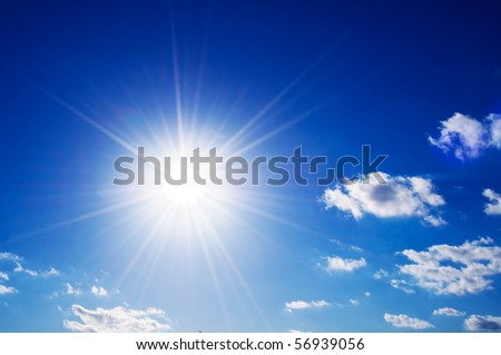 Sunny blue sky with fluffy clouds - stock photo