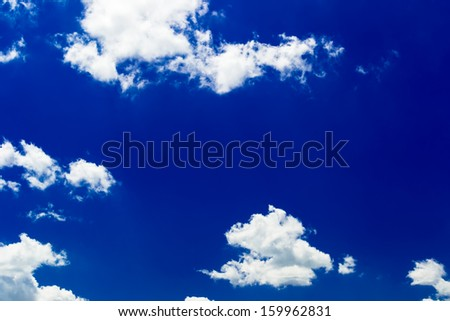 Sunny blue sky with puffy clouds - stock photo