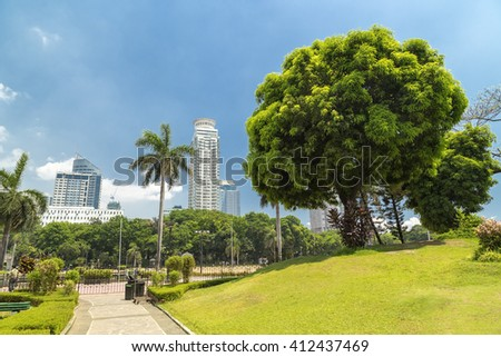 Sunny bright view from Chinese garden in Rizal park, Manila, Philippines - stock photo